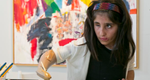 Afghani Girl Uses Prosthetic Arm To Paint & Stuns U.S Art World