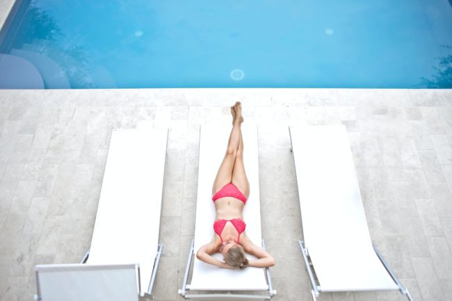 woman lying on white sun lounger 1537612 scaled e1588353945337